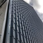 SLATE GREY TILE EFFECT ON COMMUNITY CENTRE IN GLAWAY